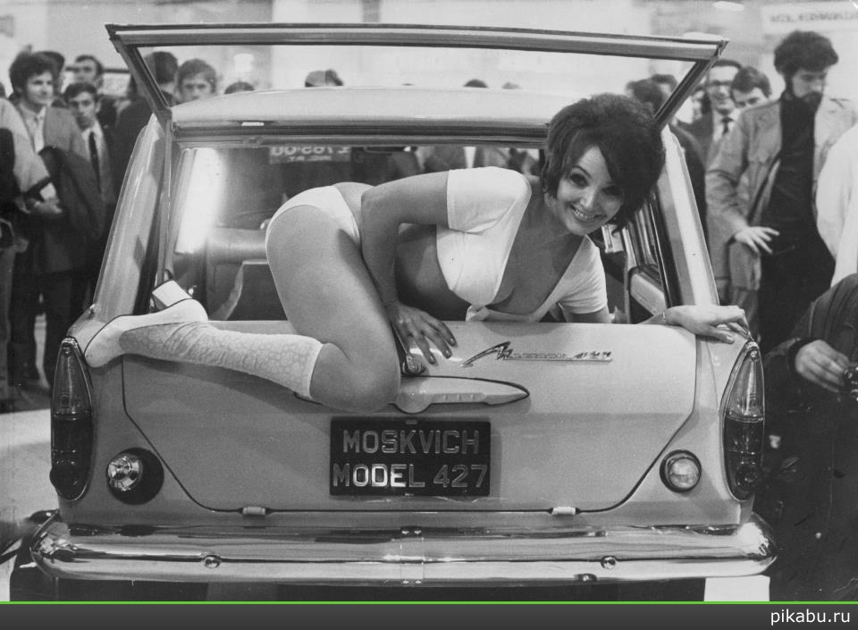 Julie Desmond, a scantily clad, 24 year old model, climbs out of the back of a Russian Moskvich 427 car